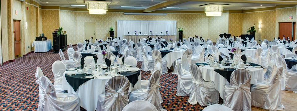Ballroom set with tables and chairs for a banquet