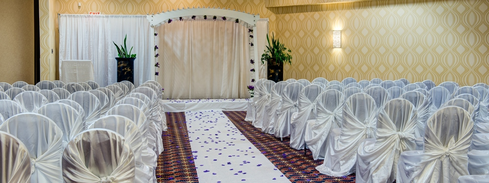 Ballroom set with a decorated arch for a wedding