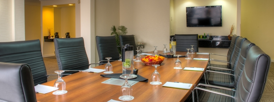 Executive boardroom with a wall-mounted TV