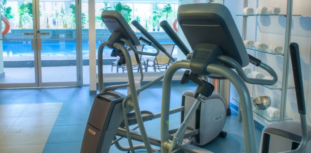 Workout equipment in fitness centre with natural lighting
