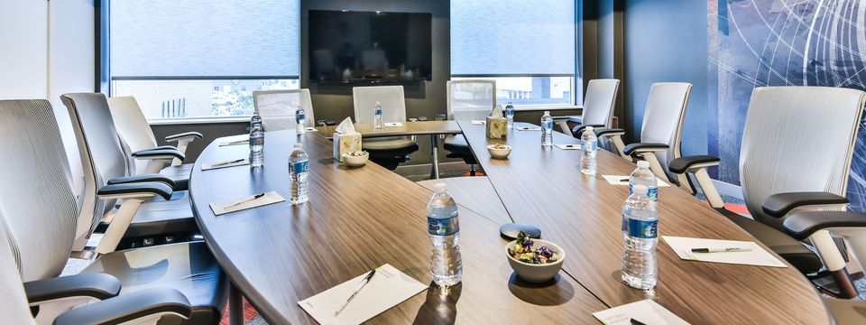 Conference room table with notepads and water in Toronto