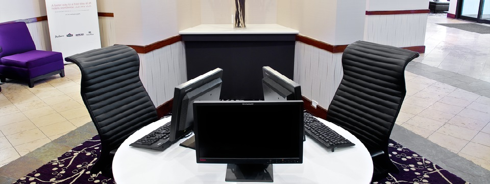 Business centre features computers and ergonomic chairs