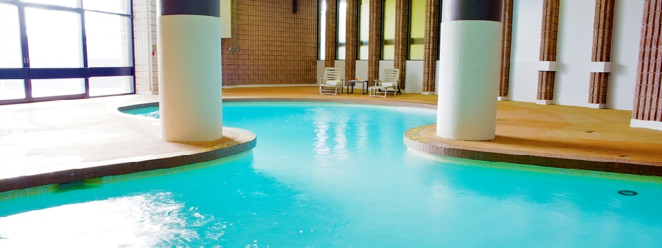 Curved indoor pool with columns