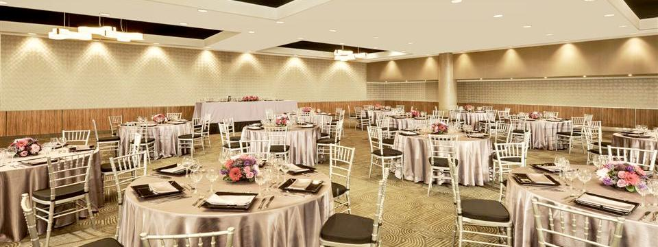 Banquet setup in the ballroom with flower arrangements