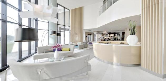 Elegant hotel lobby with white furnishings