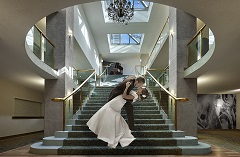 Bride and groom sharing a kiss on a staircase
