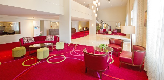 Harrisburg hotel lobby with red carpet and furniture
