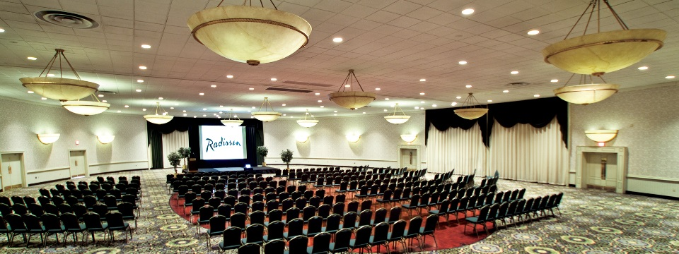 Meeting room in theater-style setup with projection screen