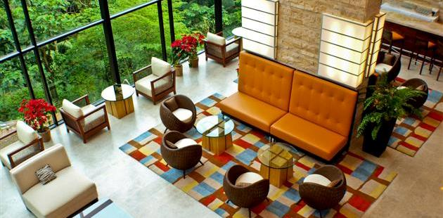 Colorful hotel lobby with patterned rug and modern seating