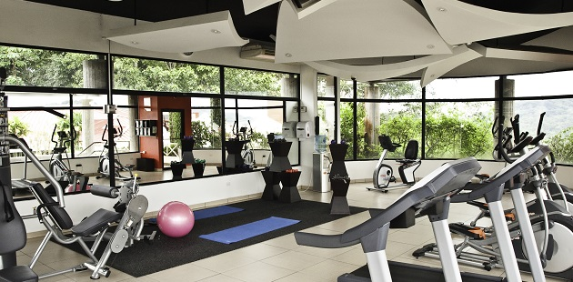 Fitness center with cardio equipment, weight machines and yoga mats