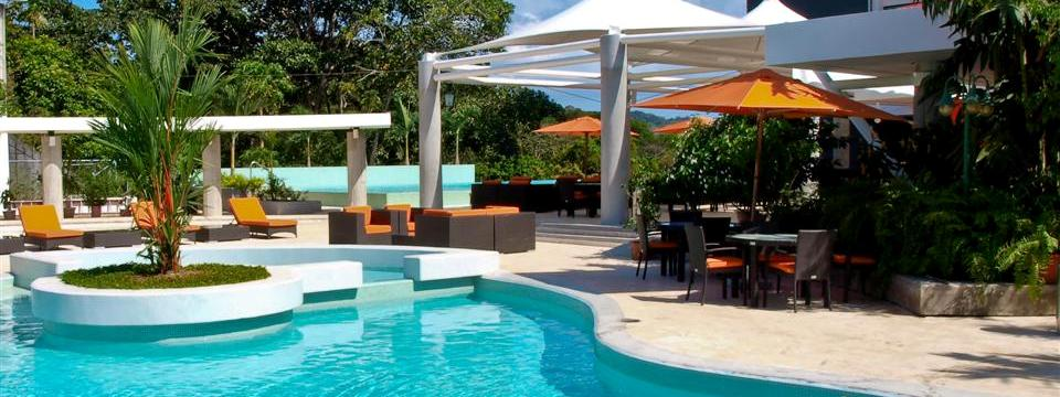 Sparkling outdoor pool with seating and umbrellas