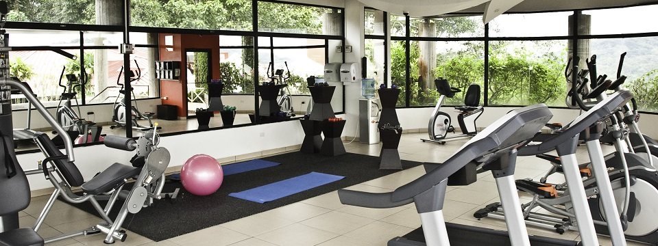 Fitness center with cardio equipment, scenic views and yoga mats