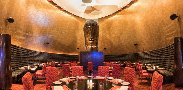 On-site restaurant with a large statue and dining tables