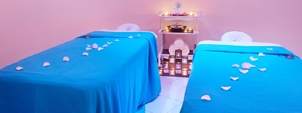 Two massage tables with flower petals