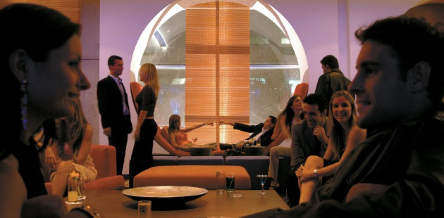 Guests enjoying drinks and socializing in the lounge area