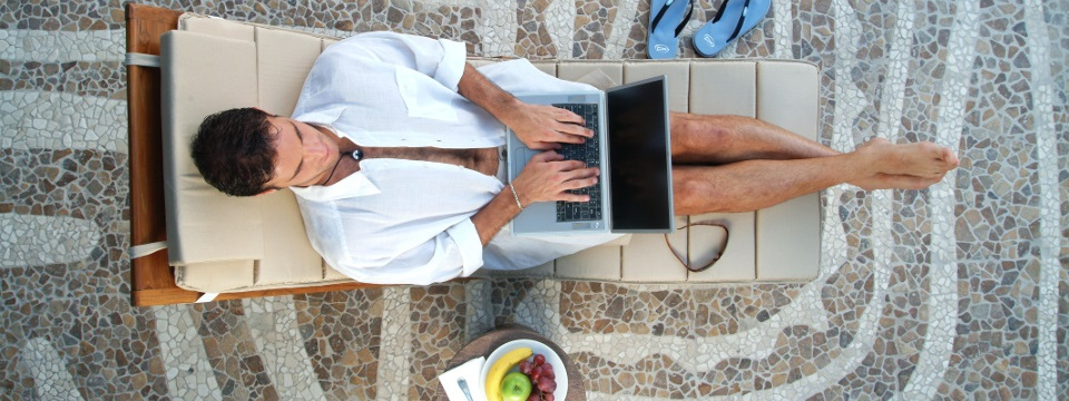 Guest with laptop in a lounge chair
