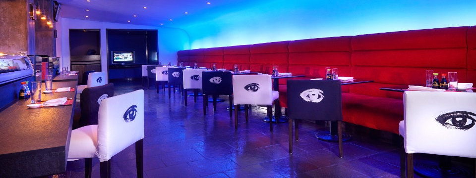Sushi dining room with eyes on the backs of chairs