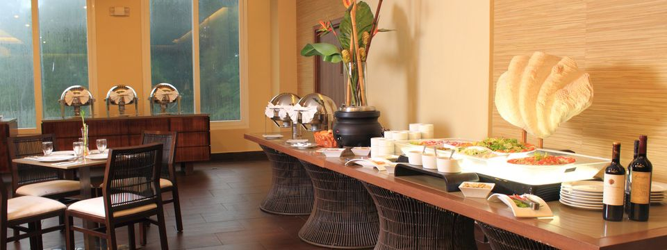 Buffet spread and table seating at Bridge View Restaurant