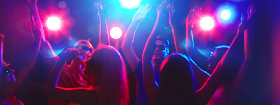 People dancing under colorful lights