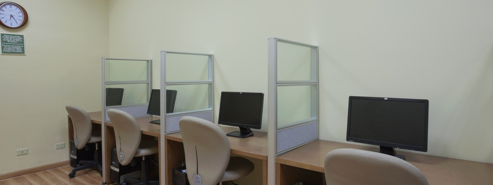 Business center with four computers and chairs
