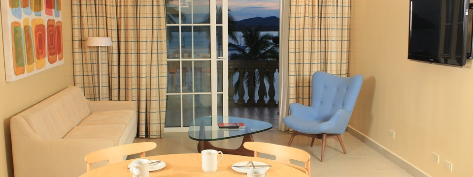 Extended Stay Villa with dining table, sofa and balcony
