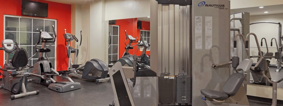 Fitness room with ellipticals and weights machine