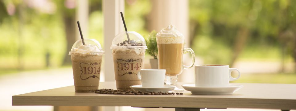 Assortment of hot and cold coffee beverages at Café 1914