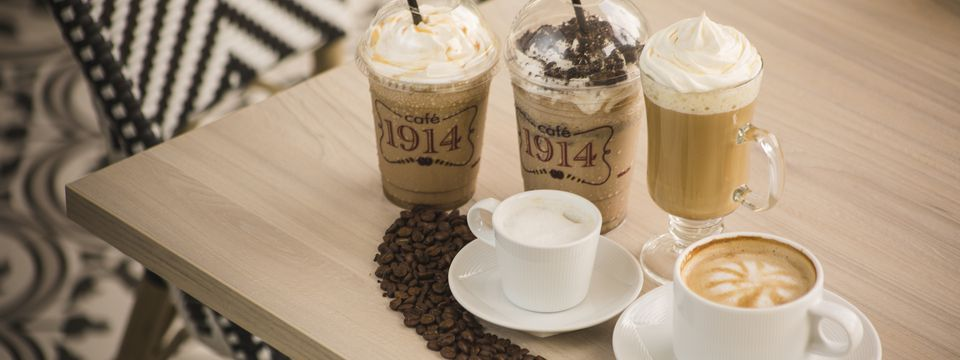 Two frappés and a variety of hot espresso drinks