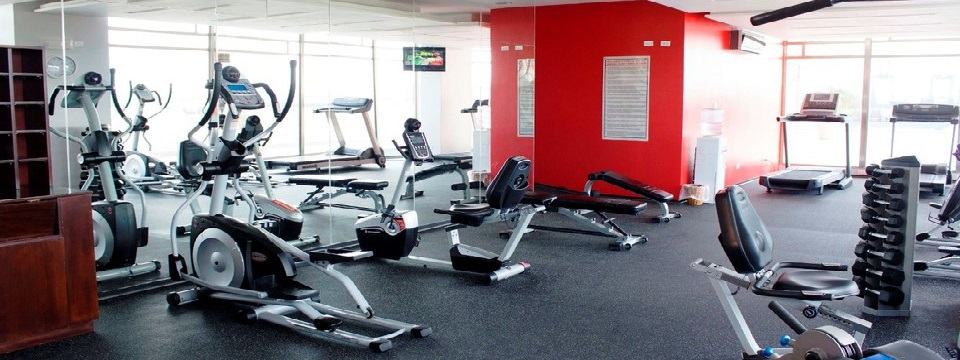 Colón hotel's fitness center with elliptical and exercise bike