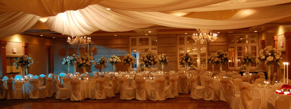 Hotel ballroom with fabric canopy and round tables