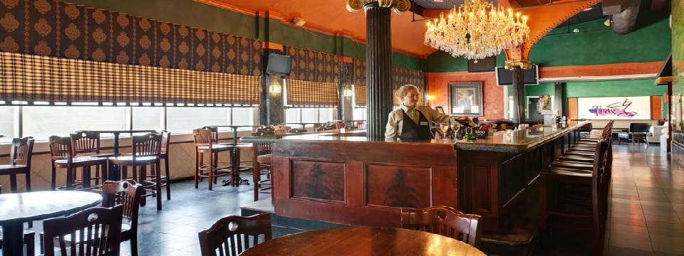 Bartender pours drink at Trax Bar + Kitchen in Scranton