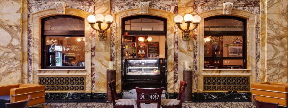 Charming hotel café with marbled walls and elegant light fixtures