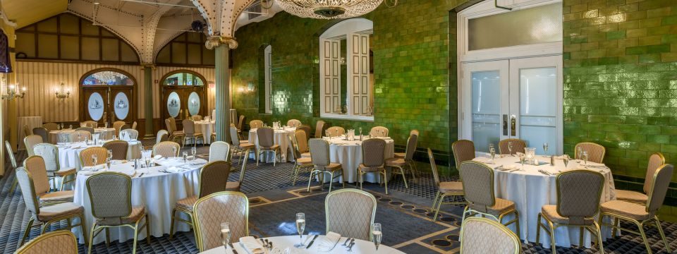 Banquet room with brick walls and French-Renaissance architecture