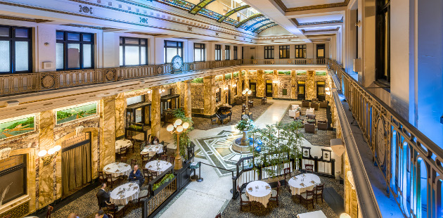 Hotel's grand lobby atrium with early 20th-century architecture