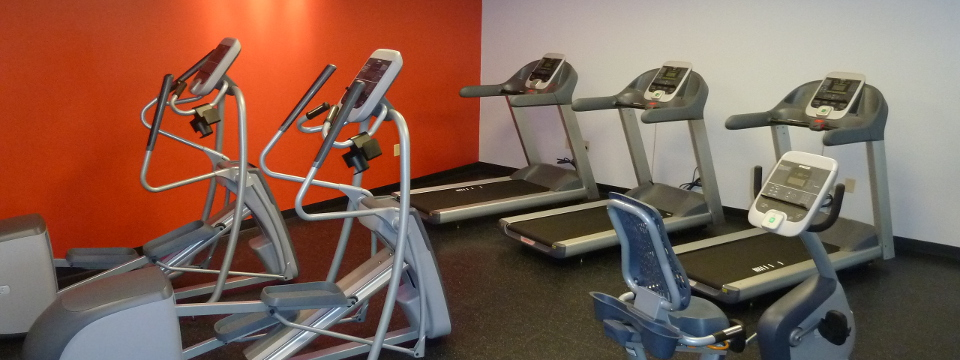 Hotel fitness center with ellipticals and treadmills