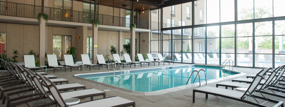 Hotel's indoor/outdoor pool with lounge chairs