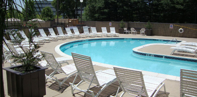 Hotel's outdoor pool with a sundeck and plenty of seating