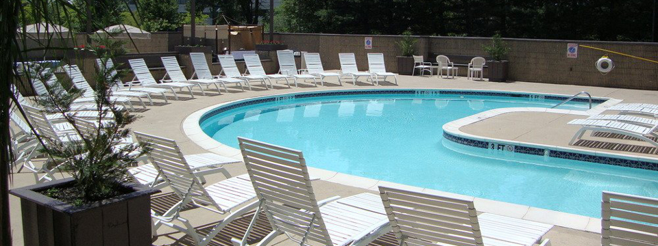 Lounge chairs on the sundeck around the hotel's outdoor pool