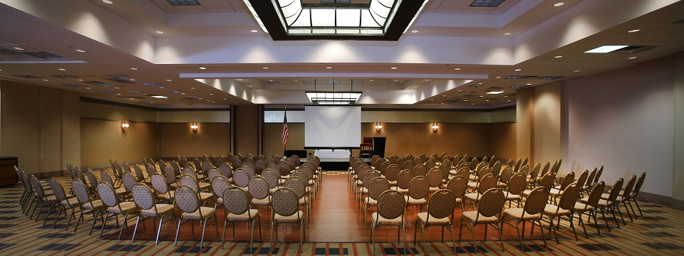 Hotel's Walnut Ballroom set up theater style with a projector screen