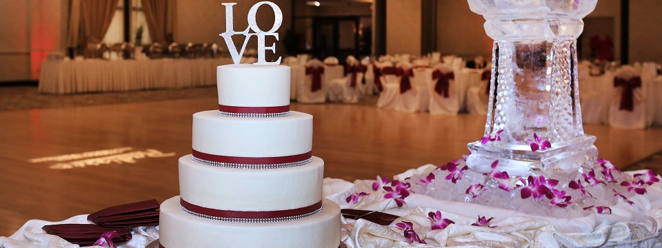 Wedding cake and ice sculpture beside the ballroom dance floor