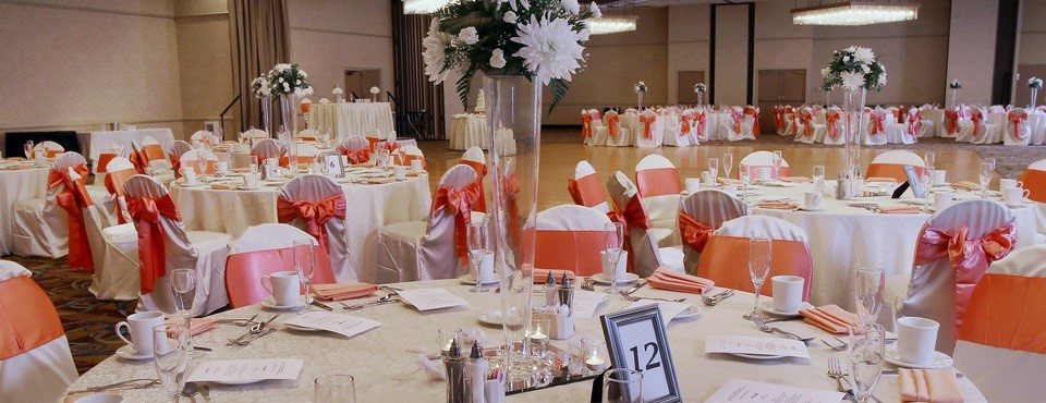 Forest Ballroom set up for a banquet with white and coral color accents