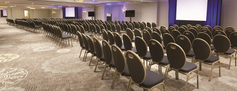 Independence Ballroom set up theater style with rows of chairs facing a presentation screen