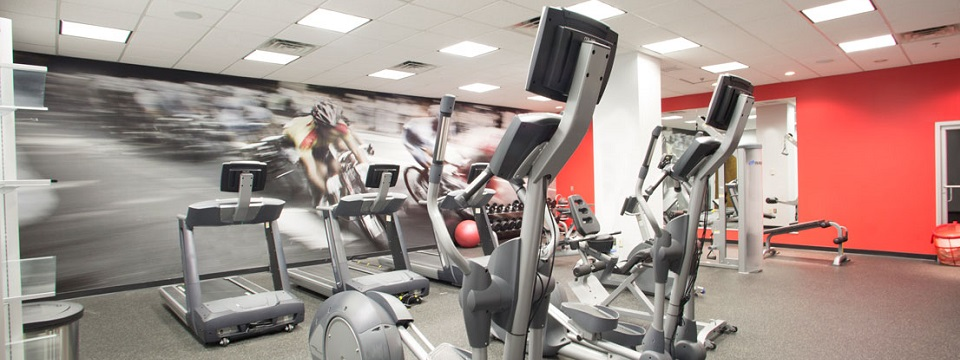 Hotel fitness center with treadmills, ellipticals and free weights