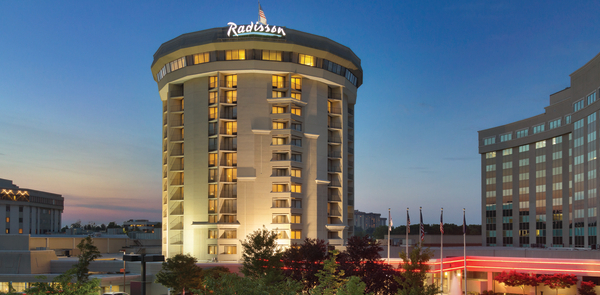 Radisson Hotel Valley Forge exterior lit up at dusk