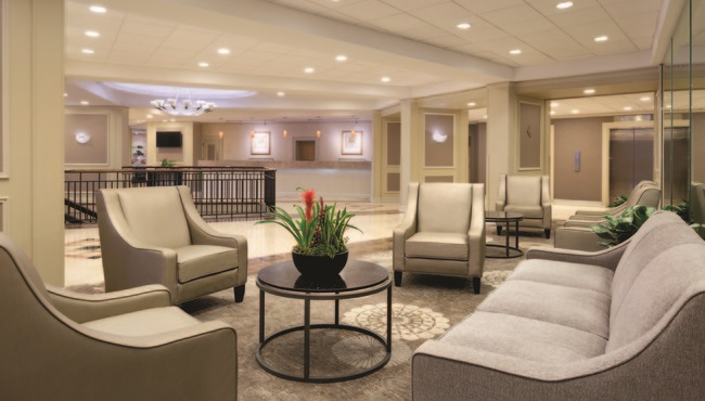 Elegant hotel lobby with plush seating and neutral tones