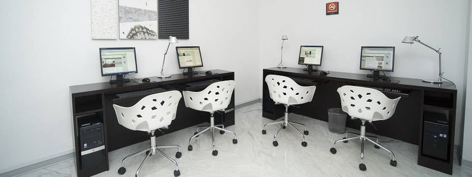 Modern chairs and four computers in the business center