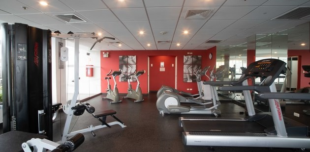 Fitness center with a multi-gym, a treadmill, two ellipticals and two recumbent bikes