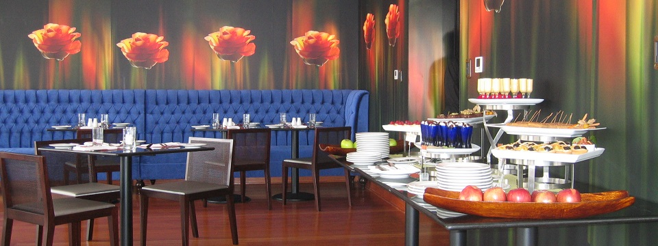 Blue booths and floral wall decor at Miso Restaurant in Lima