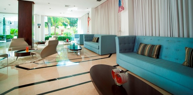 Colorful lobby with teal couches and natural light