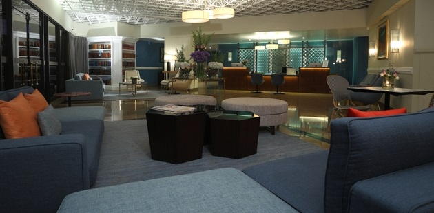 Lobby seating area with blue sofas